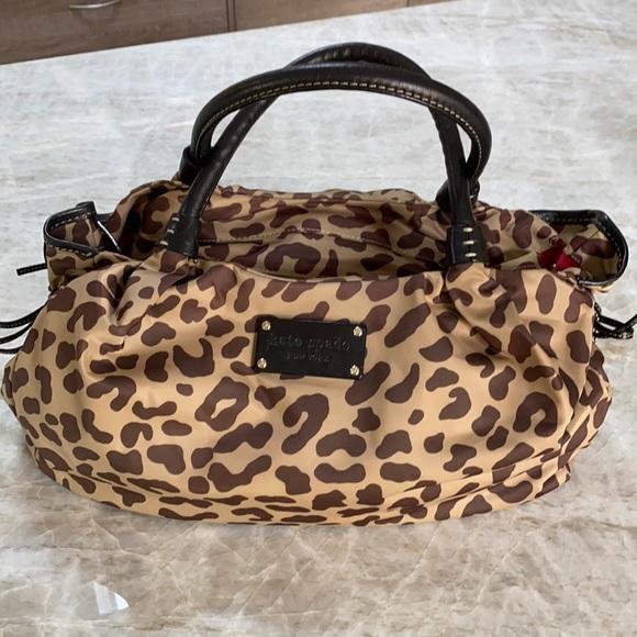 Kate Spade leopard material purse.